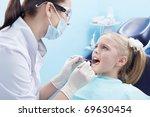 The dentist treats teeth patient - stock photo