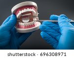 stomatology appointment ... | Shutterstock . vector #696308971