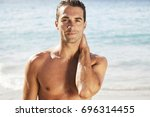 smiling shirtless handsome man... | Shutterstock . vector #696314455