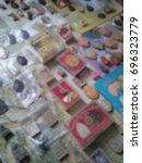 Small photo of Blurred photo of a lot amount of small buddha images