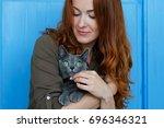 cheerful redhead girl plays... | Shutterstock . vector #696346321