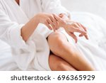 clean female person applying... | Shutterstock . vector #696365929
