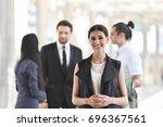 portrait of confident beautiful ...   Shutterstock . vector #696367561