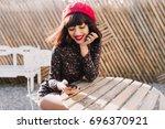 lovely girl with short hair...   Shutterstock . vector #696370921
