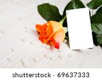 Beautiful rose with pearls and hearts as a gift for Valentine's day. With copy-space. - stock photo
