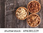 bowl of nuts | Shutterstock . vector #696381229