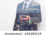 double exposure of businessman... | Shutterstock . vector #696383119