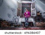 beautiful woman wearing nyonya... | Shutterstock . vector #696386407