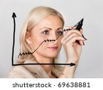 Businesswoman drawing growth chart - stock photo