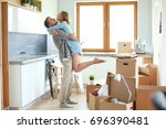 portrait of young couple moving ... | Shutterstock . vector #696390481