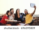 group of young friends is... | Shutterstock . vector #696395809