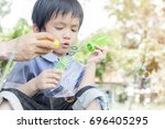 cute asian child playing with... | Shutterstock . vector #696405295
