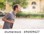 young man spit out alcohol in... | Shutterstock . vector #696409627