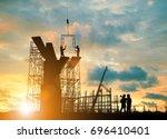 silhouette engineer  look team... | Shutterstock . vector #696410401