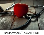 stethoscope  heart shaped and... | Shutterstock . vector #696413431