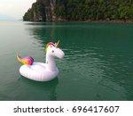 unicorn swim tube floating on... | Shutterstock . vector #696417607