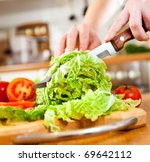Woman's Hands Cutting Lettuce ...