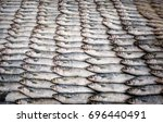fresh rows of fish for sale in... | Shutterstock . vector #696440491