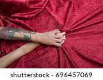 couple holds hands tight... | Shutterstock . vector #696457069