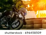 man riding sport motorcycle on... | Shutterstock . vector #696458509