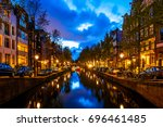 night shot of amsterdam canals... | Shutterstock . vector #696461485