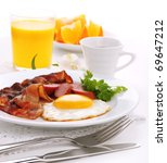Breakfast with bacon, fried egg and orange juice on white isolated background - stock photo