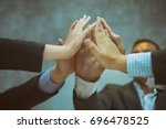 business people high fives... | Shutterstock . vector #696478525