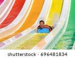 Man Having Fun On A Water Slid...