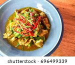 pork spicy curry homemade with... | Shutterstock . vector #696499339