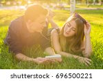 loving young couple in summer... | Shutterstock . vector #696500221