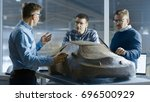 team of automotive design... | Shutterstock . vector #696500929