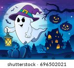 ghost with hat and lantern... | Shutterstock .eps vector #696502021