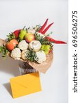 Small photo of autumn bouquet of fresh fruits, vegetables and mushrooms as concept of accumulate vitamins for the winter