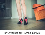 the legs of a beautiful young... | Shutterstock . vector #696513421