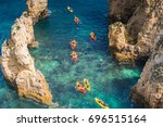 cliffs at lagos  algarve  ... | Shutterstock . vector #696515164