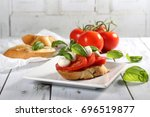 tomato  mozzarella cheese ... | Shutterstock . vector #696519877