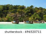 long tail boat parking at... | Shutterstock . vector #696520711