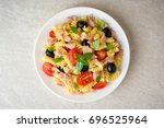 fusilli pasta salad with tuna ... | Shutterstock . vector #696525964