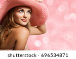 beautiful young woman wearing a ... | Shutterstock . vector #696534871