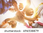 low angle view of smiling... | Shutterstock . vector #696538879