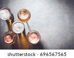 beer glasses on gray stone... | Shutterstock . vector #696567565