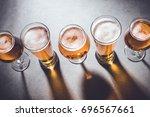 beer glasses on gray stone... | Shutterstock . vector #696567661