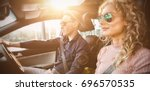 couple driving car during test... | Shutterstock . vector #696570535