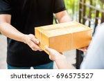 customer receiving parcel from... | Shutterstock . vector #696575527