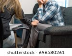 employer comforting unemployed... | Shutterstock . vector #696580261