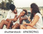 young mixed race family sitting ... | Shutterstock . vector #696582961