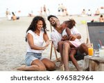 young mixed race family sitting ... | Shutterstock . vector #696582964