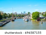 Small photo of Rotterdam, The Netherlands - July 18, 2016: The Veerhaven History Harbor seen from a boat crossing the Maas river