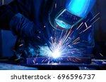 welder erecting technical steel.... | Shutterstock . vector #696596737