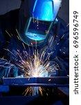 welder erecting technical steel.... | Shutterstock . vector #696596749